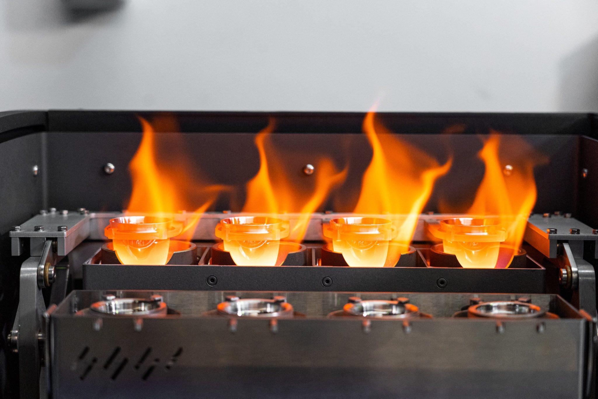 4 inconel 625 crucibles being held over intense heat