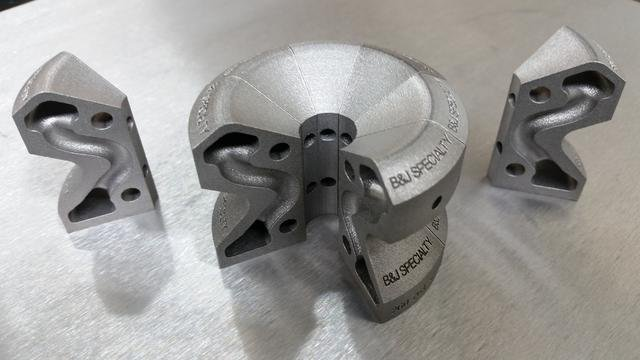 Small image depicting 3d printed part - it has cooling line channels that are curved, conforming to the optimal shapes the part needs to cool