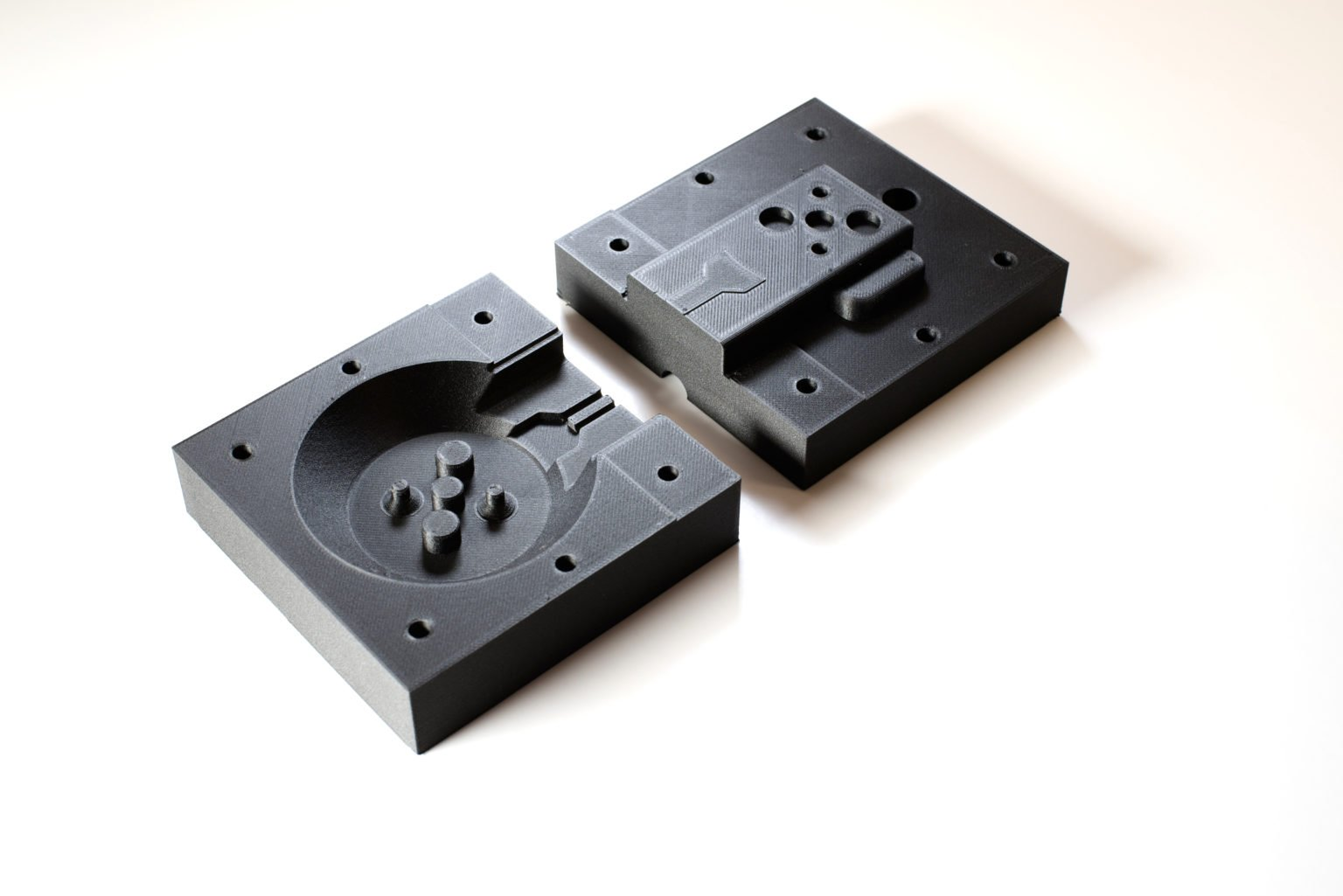 A thermoset mold printed out of Onyx with precision fittings matching Humanetics designs.